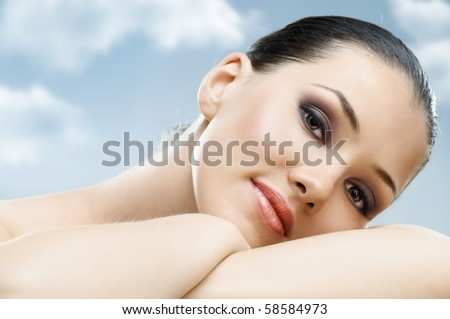 a beauty girl on the sky background - stock photo