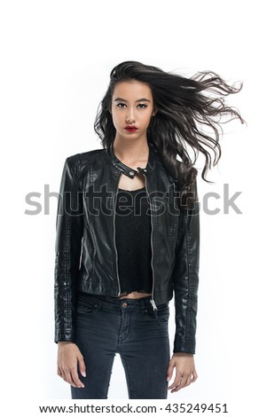 A beauty portrait of an attractive young girl wearing a leather jacket on a white background - stock photo
