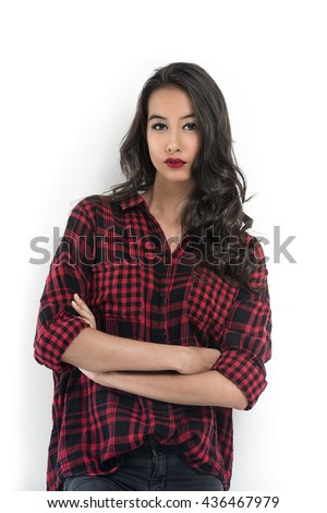 A beauty portrait of an attractive young girl wearing flannel shirt with white background