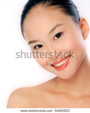 A beauty shot of an attractive Chinese woman a young Asian woman smiling with perfect skin  China