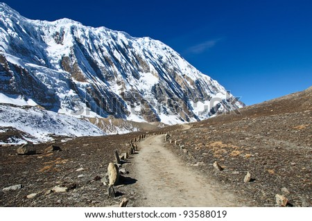 A beauty trail to the lake Tilicho in Nepal - stock photo
