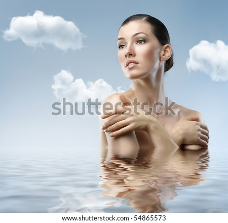 a beauty woman on the sky background - stock photo