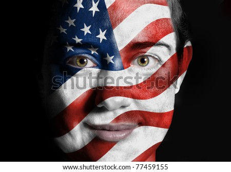A beauty woman with the Flag of United States of America painted on her face