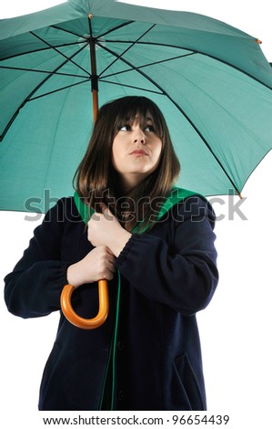 a beautyful girl holds an umbrella in studio - stock photo