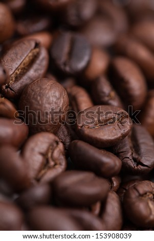 A bed of delicious and fragrant coffee beans - stock photo