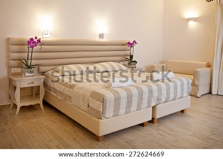 a bedroom on a hotel - stock photo