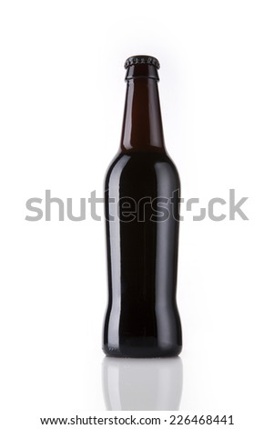 A beer bottle at reflective bottom isolated white - stock photo