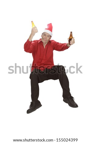 A beer for each hand, this office worker looks like he's partied hard at the holiday party! - stock photo