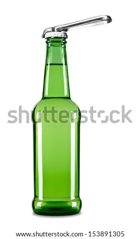A beer opener on top of a beer bottle. - stock photo