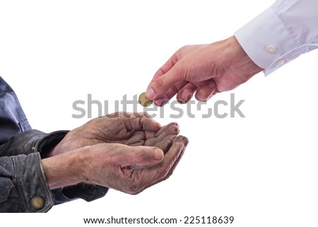 A beggar receiving money from a kind manÃ?Â?? Isolated on white background with clipping path included . - stock photo