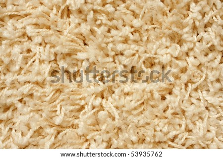 A beige carpet texture, close-up - stock photo