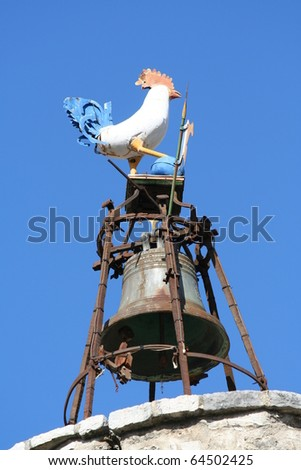 A bell tower in southern France (Anduze), with a cock on top. - stock photo