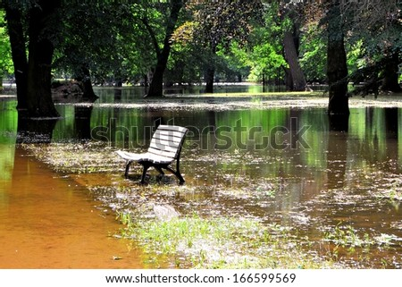 a bench in a flooded park in Magdeburg - stock photo