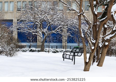 A bench in snow - stock photo