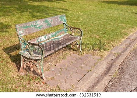 A bench in the alley in the park on a sunny day with