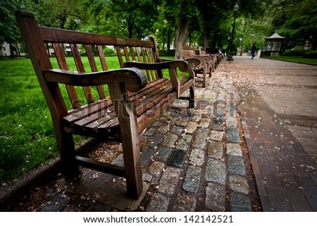 A bench in the Rittenhouse Square park in Philadelphia, Pennsylvania. - stock photo