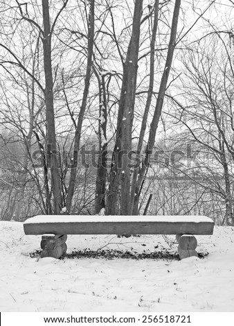 A bench in the snow.  - stock photo
