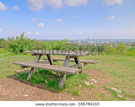 A bench on a heath. In the background you can see Vienna,  - stock photo