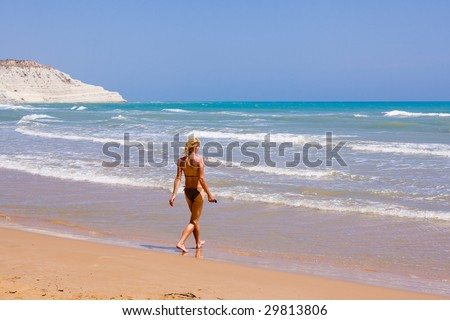 a beutiful woman on the beach in Mediterranean