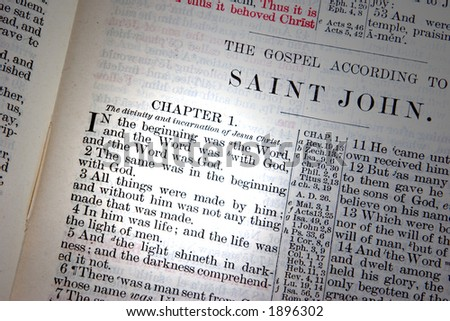 A bible opened to John Chapter one. - stock photo