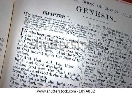 A bible opened to the first chapter of Genesis, the creation.