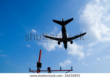 A Big Airplane Landing at the Airport - stock photo