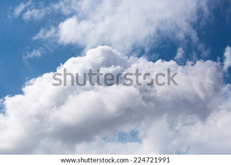 A big bright fluffy clouds in blue sky - stock photo