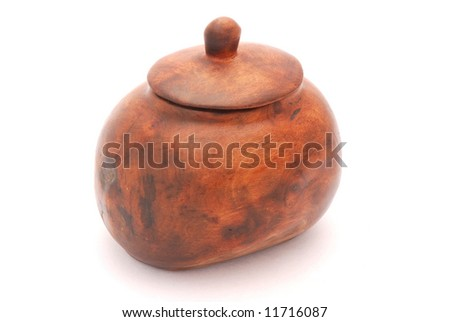 A big brown wooden African pot closed with lid isolated on white background