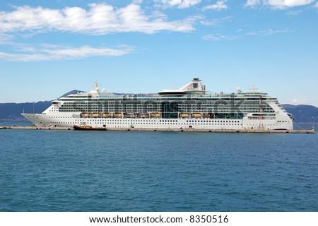 a big cruise ship docked in marine