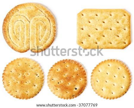 A big detail of crackers of various shapes and colors - stock photo