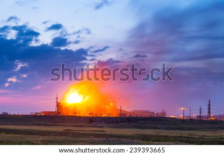 A big fire burning in a industrial buildings - stock photo
