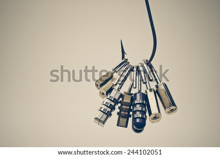 A big fish hook with security locks - Computer data theft concept / phishing - stock photo