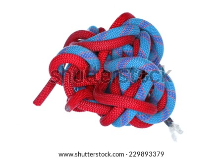 a big knot with re and blue colored ropes - stock photo