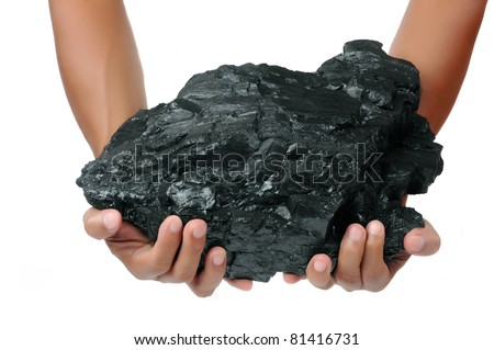 a big lump of coal is held with two hands isolated on white background - stock photo