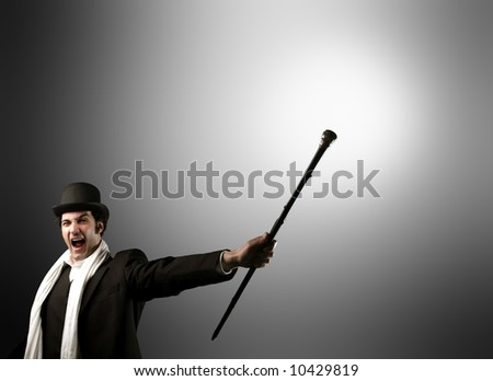 a big man with a hut and stick - stock photo