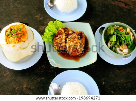 A big meal of Thai food which mainly consist of seafood ingredients - stock photo