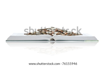 A big open book with coins. Reading makes you richer- concept. Isolated on white. - stock photo