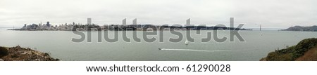 A big panoramic view of the San Fransisco bay area from the pacific side of The Golden Gate in a cloudy day - stock photo