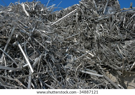 A big pile of aluminum scrap for recycling - stock photo
