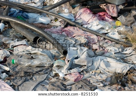 A big pile of rubbish on the ground - stock photo