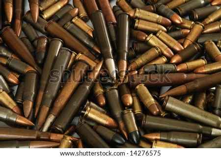 A big pile of various gun bullets - stock photo