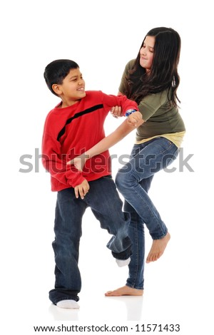 A big sister fighting with her little brother.  Isolated on white. - stock photo