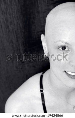 """A big smile from a cancer patient """"says never give up"""". Black and white half portrait  with special DOF in studio shot - stock photo"""