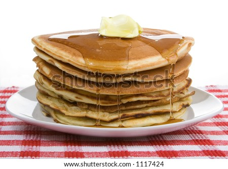 A big stack of pancakes, drizzled with syrup and a dollop of butter. Country style. - stock photo