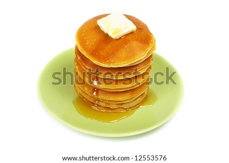 A big stack of pancakes with syrup on the green plate. Shallow depth of field - stock photo