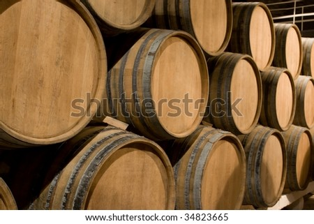 A big stack of wine barrel. - stock photo