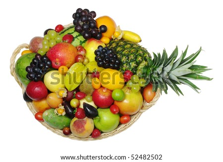 A big variety of exotic fruits in a basket  (isolated) - stock photo
