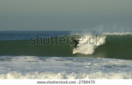 A big wave rider at San Diego - stock photo
