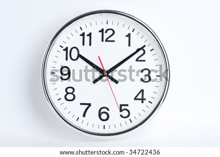 a big white clock shows the time - stock photo