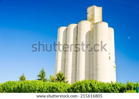 A big white grain silo - stock photo